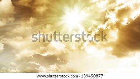 Sun rays in cloudy sky - stock photo