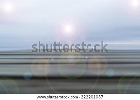 sun rays over seascape - stock photo