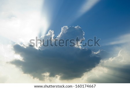 Sun rays through the clouds  - stock photo