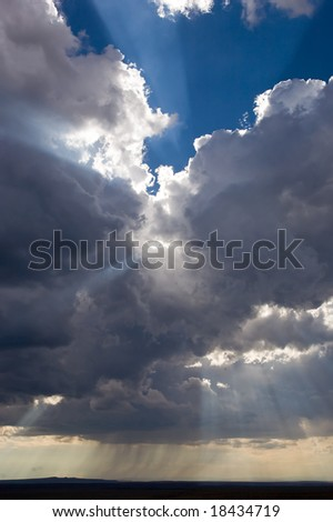 Sun Rays with Rain - stock photo