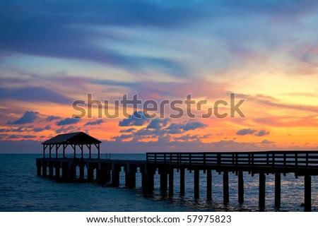 Sun Reflecting on pier in Kauai - stock photo