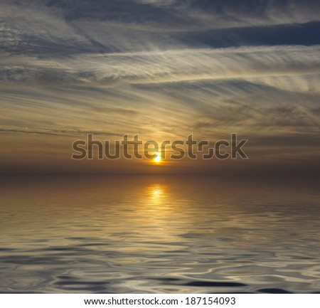 Sun reflection at sunset sunrise over the water - stock photo