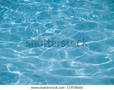 Sun reflections in pool water from above - stock photo