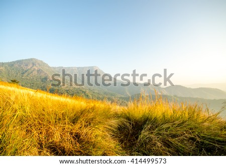 Sun rise at mountain and Meadow. Phetchabun Thailand - stock photo