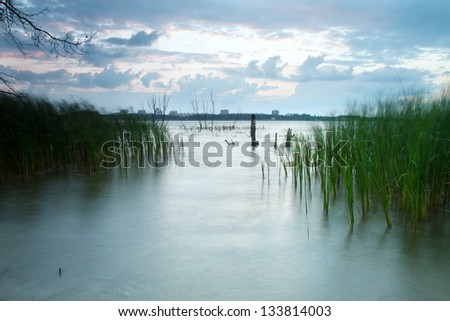 sun rises from the river is about to dawn - stock photo