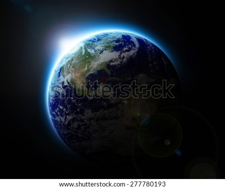 Sun rising over blue planet Earth as seen from space, parts of this image furnished by NASA - stock photo