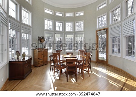 Sun room in luxury home with wall of windows - stock photo