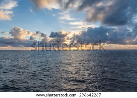 Sun set at sea in the ocean - stock photo