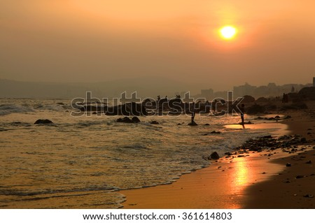 Sun set over Visakhapatnam beach in Andhra Pradesh, India - stock photo