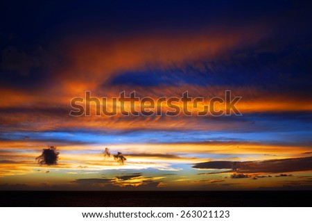 Sun Setting on the Atlantic Ocean in Tenerife, Canary Islands, Spain - stock photo
