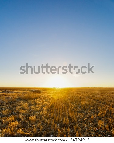 Sun Setting over Australian farmland - stock photo