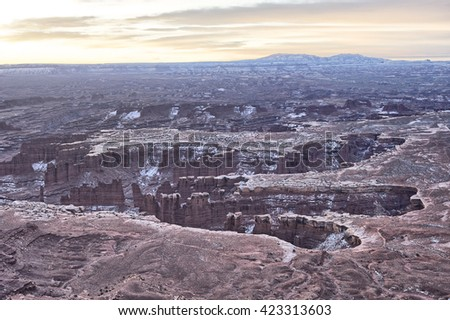 Sun setting over Canyonlands National Park - stock photo