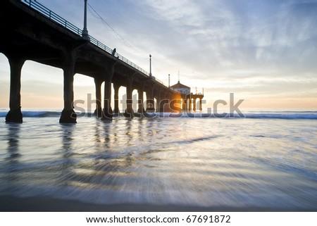 Sun Setting Through the Manhattan Beach Pier - stock photo