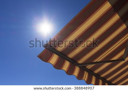 Sun shade  with blue sky in the background - stock photo