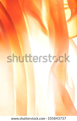Sun shines through the curtains on bright summer day. - stock photo