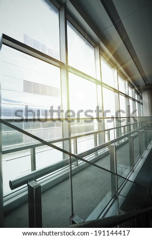 Sun shining glass windows at morden office building - stock photo