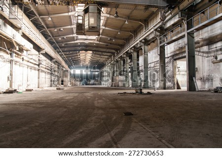 sun shining through dust in factory - stock photo