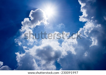 Sun shining through the clouds and a beautiful view - stock photo