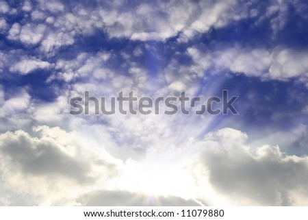 Sun shining with low and high clouds - stock photo