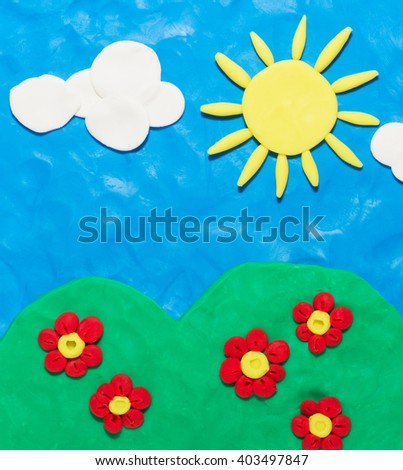 Sun,sky,flower. It is made of plasticine. - stock photo