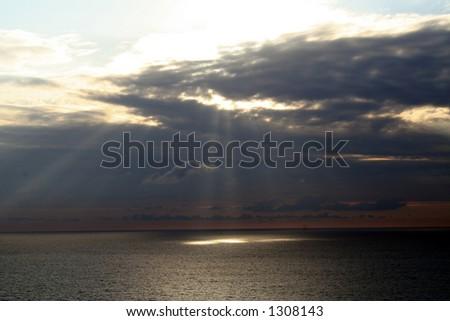 sun spot light on the Mediterranean sea. - stock photo