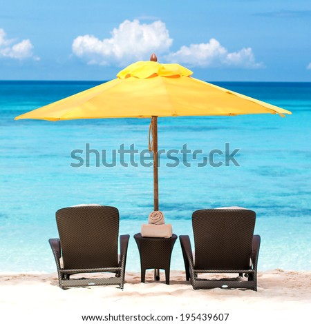 Sun umbrella and beach chairs on tropical beach, Boracay - stock photo