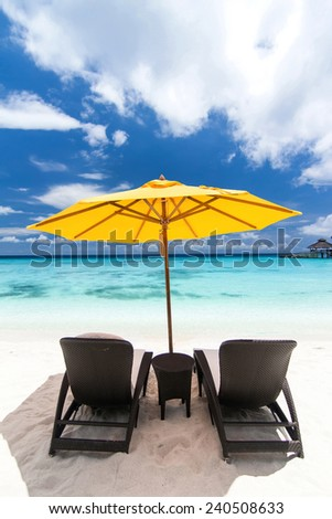 Sun umbrellas and chairs on caribbean beach - stock photo