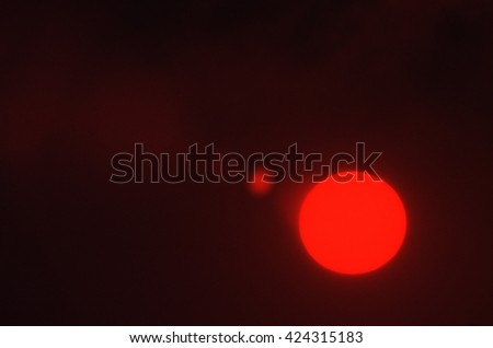 sun with red filter - stock photo