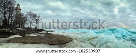 Sunbeam Near Snow Covered River. - stock photo