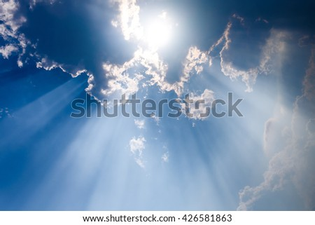 Sunbeam through the haze on blue sky , clouds with sun rays - stock photo