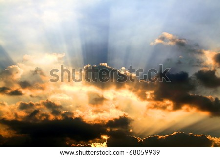 sunbeams and clouds - stock photo