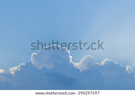 sunbeams over-clouds on blue sky background  - stock photo