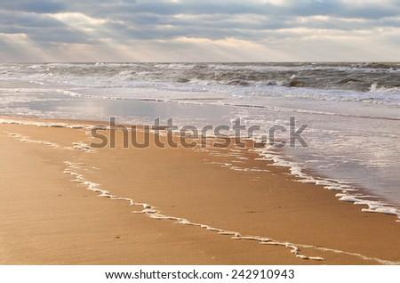 sunbeams over North sea beach, Zandvoort, North Holland, Netherlands - stock photo
