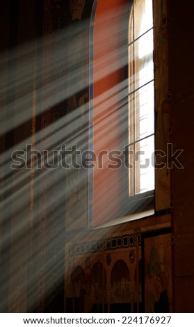 Sunbeams passing through window in Armenian church of Lviv with warm tones - stock photo