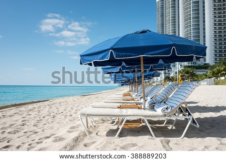 Sunbed and umbrella on the beach - stock photo