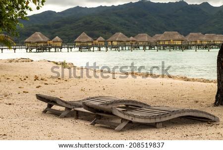 Sunbeds at Idyllic scene of travel destination - stock photo