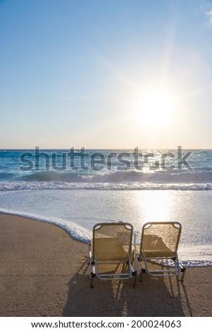 Sunbeds on Kathisma beach in Lefkada Greece - stock photo