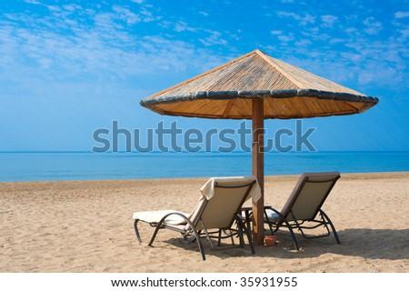 Sunbeds on the beach in Turkey - stock photo