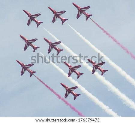 SUNDERLAND, UK - JULY 27th 2013: The RAF Red Arrows fly in formation at the Sunderland Air show 2013 - stock photo