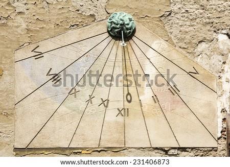 Sundial clock on old house wall in Tkalciceva street in Zagreb, Croatia  - stock photo