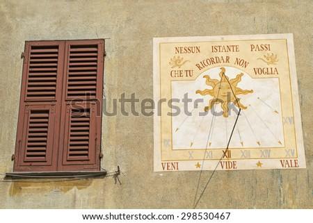 Sundial on a old Mediterranean house in Sassello - stock photo