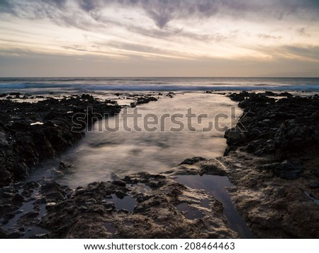 sundown above the west coast of Tenerife - stock photo