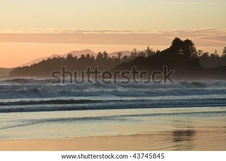 Sundown at the Pacific Ocean near Tofino, Canada. - stock photo
