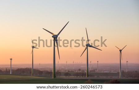 sundown on a wind farm - stock photo
