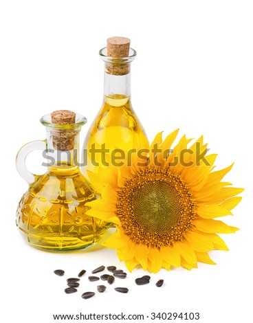sunflower oil and seeds isolated on white background - stock photo