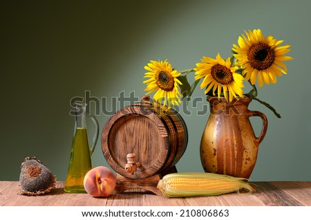 Sunflower oil and wooden barrel on the table - stock photo