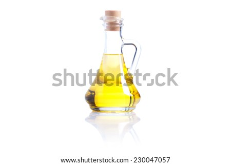sunflower oil in a pot isolated on white background with reflection - stock photo