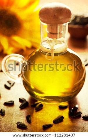 Sunflower oil, sunflower seeds and flower - stock photo