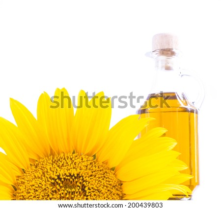 Sunflower oil with flower on the white background. - stock photo