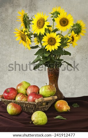 Sunflowers and apples - stock photo